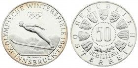 Austria 50 Schilling 1964 Averse: Value within beaded circle; small spray of leaves below; 3/4 circle of shields surrounding. Reverse: Innsbruck - Ski...
