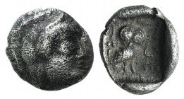 Attica Athens, c. 500/490-485/80 BC. AR Obol (8mm, 0.46g, 1h). Helmeted head of Athena r. R/ Owl standing r., head facing; olive sprig and crescent to...