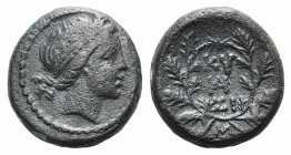 Mysia, Kyzikos, 2nd-1st century BC. Æ (16mm, 5.38g, 12h). Head of Kore Soteira r., wearing wreath of grain. R/ KY-ZI and monogram within an oak wreath...
