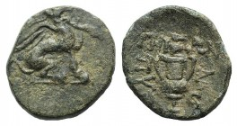 Ionia, Teos, c. 370-330 BC. Æ (17mm, 3.33g, 12h). Pythion, magistrate. Griffin seated r., forepaw raised. R/ Grape bunch over kantharos. SNG Copenhage...