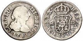 1782. Carlos III. Madrid. JD. 1/2 real. (AC. 166). 1,47 g. Golpecito. Ex Colección Iriarte, Áureo 04/03/1998, nº 61. BC+/MBC-.