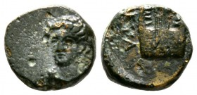 Cyprus, Curium, 4th century BC, Æ, 2.10g, 12mm. Head of young Apollo three-quarters left / Lyra, EVA to left. A Catalogue of the Coins of Cyprus, Elia...