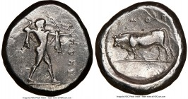 LUCANIA. Poseidonia. Ca. 470-420 BC. AR stater (19mm, 11h). NGC Fine, brushed. ΠΟΣE, Poseidon striding right, nude but for chlamys spread across shoul...
