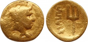 KINGS OF MACEDON. Philip II (359-336 BC). GOLD 1/8 Stater. Pella. Obv: Head of Herakles right, wearing lion skin. Rev: ΦΙΛIΠΠOY. Trident. SNG ANS 233....