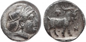 TROAS. Antandros. Early 4th century BC. Trihemiobol. Obv: Head of Artemis Astyrene to right. Rev: ANTA-N Goat standing right; above, grape. SNG Copenh...