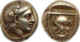 LESBOS. Mytilene. EL Hekte (Circa 377-326 BC). Obv: Head of Dionysos right, wearing ivy wreath. Rev: Facing head of Silenos within linear square. Bode...