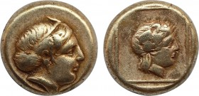 LESBOS. Mytilene. EL Hekte (Circa 412-378 BC). Obv: Horned head of Io right, wearing tainia. Rev: Head of Dionysos right, wearing ivy wreath; all with...