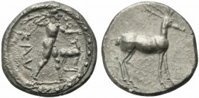 Bruttium, Caulonia, Stater, ca. 475-425 BC; AR (g 8,05; mm 22; h 12); KAV, Apollo naked, advancing r., holding a branch in uplifted r. hand and a smal...