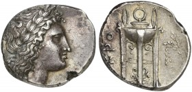 Bruttium, Croton, Nomos, ca. 300 BC; AR (g 7,37; mm 21; h 4); Laureate head of Apollo r., Rv. KPO, tripod; on r., filleted laurel branch. HN Italy 217...