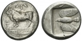 Cyprus, Paphos, Stater struck under Onasioikos, ca. 450-440 BC; AR (g 10,81; mm 21; h 9); Bull standing l. on beaded line; above, winged solar disk; o...