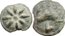Greek Italy. Northern Apulia, Luceria. Light series. AE Cast Teruncius, c. 217-212 BC. Star of eight rays. / Dolphin right. Above, three pellets. Belo...