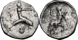 Greek Italy. Southern Apulia, Tarentum. AR Nomos, c. 470-425 BC. Taras astride dolphin right, with extended arms; below, shell; to left, traces of eth...