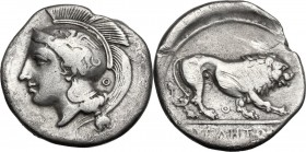 Greek Italy. Northern Lucania, Velia. AR Didrachm, c. 340-334 BC. Head of Athena left, wearing Attic helmet decorated with griffin; behind Θ. / Lion w...