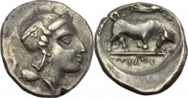 Greek Italy. Southern Lucania, Thurium. AR Diobol, unofficial issue, 3rd century BC. Head of Athena right, wearing crested Attic helmet. / Bull chargi...