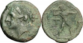 Greek Italy. Bruttium, Brettii. AE Half Unit, c. 214-211 BC. NIKA. Diademed head of Nike left; to right, corn-ear. / BPETTIΩN. Zeus striding right, hu...