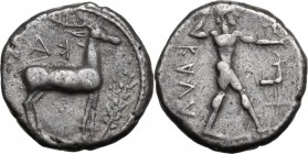 Greek Italy. Bruttium, Kaulonia. AR Nomos, c. 450 BC. ΚΑVΛ (retrograde). Apollo walking right, holding laurel branch and small running daimon; to righ...