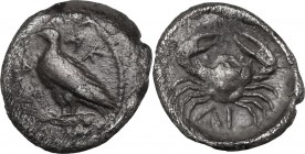 Sicily. Akragas. AR Litra, c. 450-440 BC. AK-[PA retrograde]. Eagle standing left on Ionic capital. / Crab; ΛI (mark of value) below. SNG ANS 994; HGC...