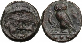 Sicily. Kamarina. AE Tetras or Trionkion, c. 420-405 BC. Gorgoneion. / KAMA. Owl standing left, head facing, grasping lizard; three pellets in exergue...
