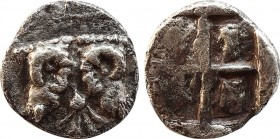 TROAS. Kebren. Obol (Late 6th-early 5th centuries BC). Obv: KEBP. Ram heads back to back, facing upwards; in between, floret. Rev: Incuse swastika pat...