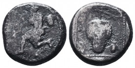 Cilicia, Soloi AR Stater. Circa 440-410 BC. Amazon kneeling to left, quiver and bowcase at her side, holding bow; helmet to right / Grape bunch; laure...