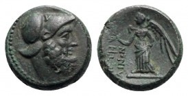 Bruttium, Petelia, late 3rd century BC. Æ (15.5mm, 4.41g, 9h). Helmeted head of Ares r. R/ Nike standing l., holding wreath. HNItaly 2456; SNG ANS 607...