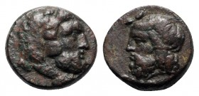 Sicily, Gela, c. 315-310 BC. Æ (16mm, 5.20g, 12h). Bearded head of Herakles r., wearing lion-skin. R/ Bearded and horned head of Gelas l. CNS III, 55;...