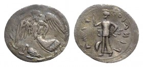 Sicily, Kamarina, c. 461-440/35 BC. AR Litra (12mm, 0.39g, 11h). Nike flying l.; below, swan standing l.; all within wreath. R/ Athena standing l., ho...