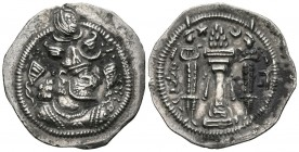SASANIDA EMPIRE, Khusro II. Drachm. (Ar. 3.11g \/ 28mm). Kirman (BN). Anv: Bust of Khusro II crowned to the right. Rev: Altar with fire between two gu...