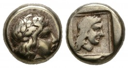 LESBOS, Mytilene. 1\/6 Stater. (El. 2.52g \/ 10mm). 412-378 BC Anv: Laureate head to the right of Apollo. Rev: Female head with long hair within incus...