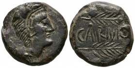 CARMO (Carmona, Seville). As. (Ae. 23.42g \/ 29mm). 80 BC Anv: Head of Hercules with lion skin on the right. Rev: Two spikes on the right, between the...