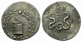 Ionia, Ephesos, c. 180-67 BC. AR Cistophoric Tetradrachm (30mm, 12.52g, 12h). Cista mystica within ivy wreath. R/ Two serpents entwined around bow and...