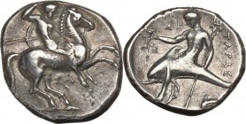 Greek Italy. Southern Apulia, Tarentum. AR Nomos, circa 315-302 BC. Warrior, holding shield and two spears, preparing to cast a third, on horseback ri...