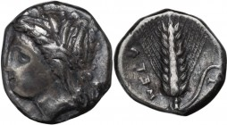 Greek Italy. Southern Lucania, Metapontum. AR Nomos, circa 330-290 BC. Wreathed head of Demeter left. / Barley ear of eight grains, leaf to right; pit...
