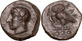 Sicily. Kamarina. AE Tetras, 425-405 BC. Head of Athena left, wearing Attic helmet decorated with wing. / Owl standing left, head facing, wings closed...