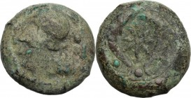 Sicily. Syracuse. Dionysios I (405-367 BC). AE 28 mm, after 395 BC. Head of Athena left, wearing Corinthian helmet. / Two dolphins; between, stars; be...