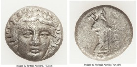 CARIAN SATRAPS. Maussollus (377-353 BC). AR drachm (14mm, 3.58 gm, 12h). Fine, porosity. Laureate head of Apollo facing, turned slightly right, hair p...