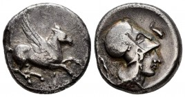 Corinthia. Corinth. Stater. 400-375 BC. (Pegasi-188/1). Anv.: Pegasos flying right. Rev.: Helmeted head of Athena right, dolphin above; behind, Zeus s...