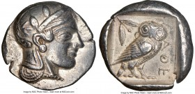 ATTICA. Athens. Ca. 455-440 BC. AR tetradrachm (25mm, 17.13 gm, 11h). NGC XF 5/5 - 4/5. Early transitional issue. Head of Athena right, wearing creste...
