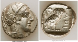 ATTICA. Athens. Ca. 440-404 BC. AR tetradrachm (26mm, 17.17 gm, 5h). AU. Mid-mass coinage issue. Head of Athena right, wearing crested Attic helmet or...