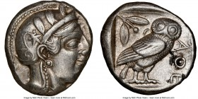 ATTICA. Athens. Ca. 455-440 BC. AR tetradrachm (23mm, 17.14 gm, 8h). NGC XF 4/5 - 4/5. Early transitional issue. Head of Athena right, wearing crested...