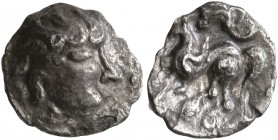 MIDDLE DANUBE. Uncertain tribe. 2nd-1st centuries BC. Obol (Silver, 9 mm, 0.52 g), 'Kapostal' type. Celticized, bearded head of Zeus to right. Rev. St...