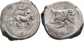 SICILY. Gela. Circa 440-430 BC. Tetradrachm (Silver, 29 mm, 17.11 g, 7 h). Charioteer driving quadriga moving slowly to the right; above, Nike flying ...