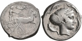 SICILY. Syracuse. Second Democracy, 466-405 BC. Tetradrachm (Silver, 26 mm, 17.18 g, 8 h), circa 420-415. Charioteer driving quadriga walking to right...