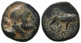 KINGS OF GALATIA. Amyntas (36-25 BC). Ae. Obv: Head of Herakles right, with club over shoulder; ЄC to left. Rev: Lion standing right; B above, monogra...