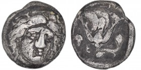 Caria, Rhodos. Circa 333-316 BC. AR Didrachm (19mm, 6.23g, 12h). Head of Helios facing three-quarters right / Rose with bud on the right, in left fiel...