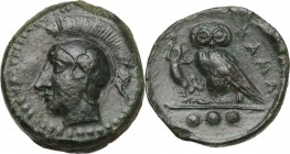 Sicily. Kamarina. AE Tetras, 425-405 BC. Obv. Head of Athena left, helmeted. Rev. Owl standing left, head facing, holding lizard; in exergue, three pe...