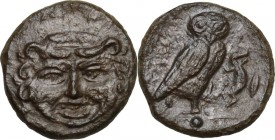 Sicily. Kamarina. AE Onkia, 425-405 BC. Obv. Gorgoneion facing. Rev. Owl standing right, head facing, wings closed, holding lizard; to right, corn-gra...