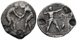 Pamphylia, Aspendos, ca. 380-325 BC AR stater Two wrestlers grappling, two countermarks Slinger in short chiton standing right, shooting his weapon, i...