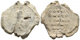 Byzantine lead seal, Theognostos, c. X century Bust of Saint facing, above inscription. Border of dots Inscription of five lines. Oranments above and ...