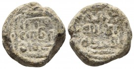 Medieval lead seal, Inscription of three lines in arabic, Inscription of three lines in arabic 18.4mm / 5.7g